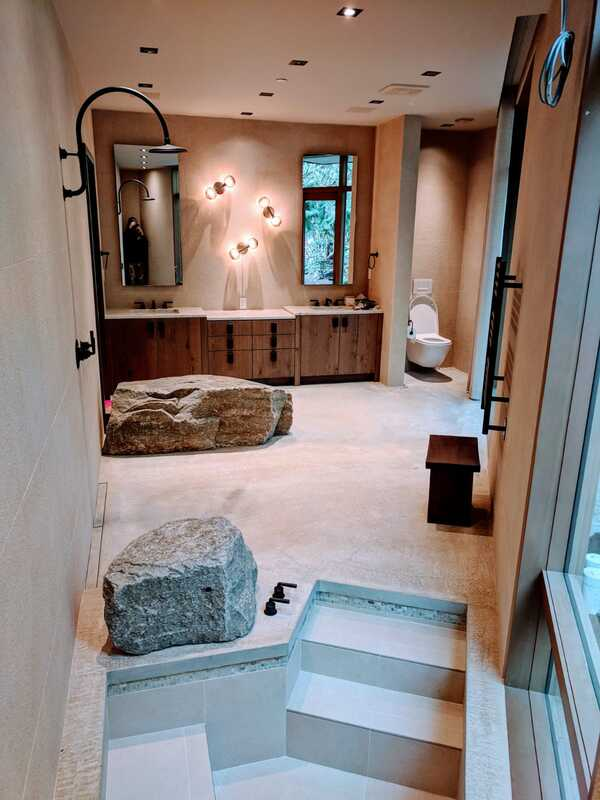 beautiful bathroom with stone bath and shower